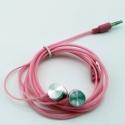 Roze stereo oordopjes met 3,5mm aansluiting om muziek of een film te luisteren op de smartphone en tablet